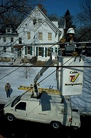 Line Technician Larry Price checks cable TV connections from bucket for Cable TV Montgomery in Rockville, Maryland.
