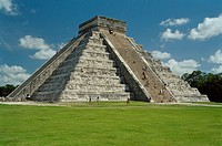 Visitors climbing the steps on the side of pyramid ruins at Chichen Itza, Yucatan, Mexico.