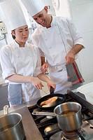 Sauteing salmon. Luis Irizar cooking school. Donostia, Gipuzkoa, Basque Country, Spain