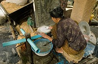 Woman making rice paper. Don Teav, Battambang province, Cambodia