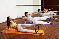 Young man and woman performing a pilates exercise