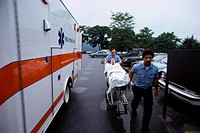 Transporting Patient Past Ambulance
