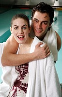 Young couple in a swimming pool at a spa