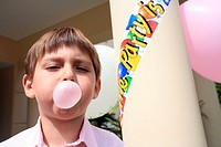 Boy doing bubble with gum