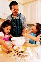 Dad Baking Cookies with Daughters