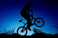 Silhouette, BMX-driver, back wheel,  drives, on the side, back light  cycling, trend sport, Funsport, man, young, teenager, 20-30 years, BMX-Fahren, B...