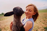 Girl Carrying Sheep