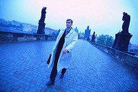 Businessman Walking on Charles Bridge (thumbnail)