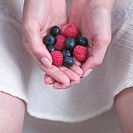 Hands Holding Berries