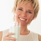 Cheerful Woman Holding Glass of Milk