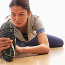 Woman Stretching Before Exercising (thumbnail)