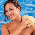 Woman Scrubbing Shoulder with Bath Sponge