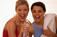 Women Drinking Water After Exercising