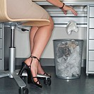 Businesswoman Throwing Paper into Bin