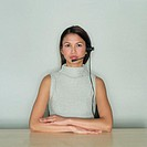 Woman Wearing Telephone Headset (thumbnail)