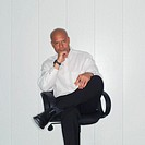 Pensive Businessman Sitting (thumbnail)