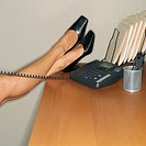 Businesswoman with Feet on Desk