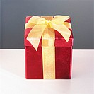 Red Box Wrapped with Gold Ribbon