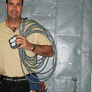Electrician Holding Outlet and Electrical Wire (thumbnail)