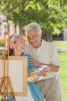 Senior Man Appreciating His Wife´s Painting