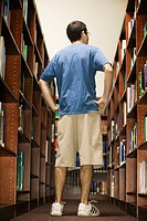 Teenager Looking for Book in Library
