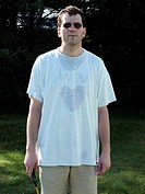 Man with a peculiar heart-shaped sweat stain after a vigorous game of badminton