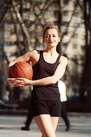 Woman Holding a Basketball