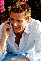 Portrait of caucasian man on the phone smiling