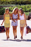 Three Girlfriends with Shopping Bags