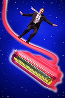 Businessman Balancing on Cable
