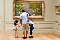 Father and 6-8 year old daughter, standing in front of Monet´s Water Lillies