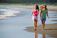 girl 13, girl 18 yrs running on beach