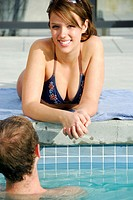 20 yr old woman smiling at poolside with boyfriend