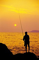 A fisherman with his steak at Hermal beach Goa, India.