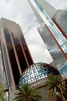 Buildings at Paseo de la Reforma, the dome of Stock Exchange building designed by architect Juan Jos&#233; D&#237;az Infante at fore, Mexico City. Mexico D.F., ...