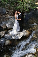 Newlyweds Hugging Near Stream