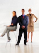 Three Blurred Businesspeople