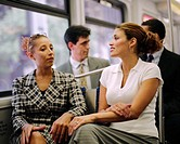 Businesswomen Riding Train