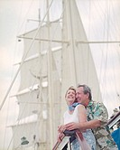 Smiling Couple Embracing on Sailboat