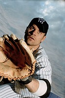 Baseball Player Holding Out Gloves
