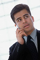 Concerned Businessman Using Cell Phone