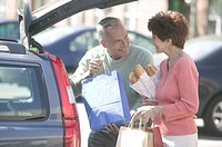 Couple Placing Bags into Their Car