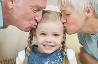 Grandparents Kissing Granddaughter