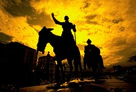 Statue of Don Quixote Silhouetted at Sunset