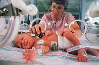 Nurse Examining Premature Newborn