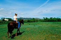 Girl Riding Horse on Farmland