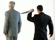 Businessman Stabbing Another With a Knife