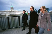 Businesspeople Walking Along River