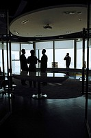 Businesspeople in office, silhouette