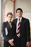 Businessman and businesswoman  looking at camera